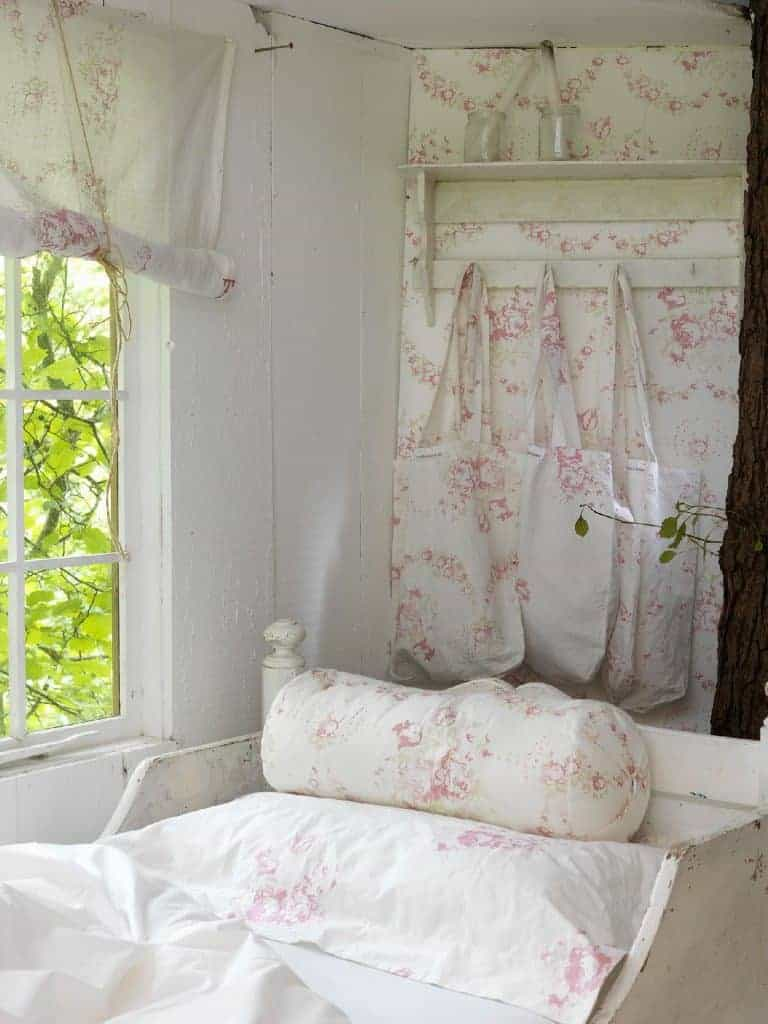 love this faded floral pink and white bedding and linens by cabbages and roses