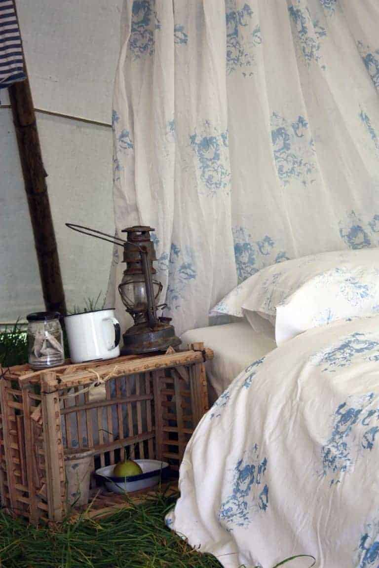 love this blue and white faded floral bedding and curtain fabric by cabbages and roses