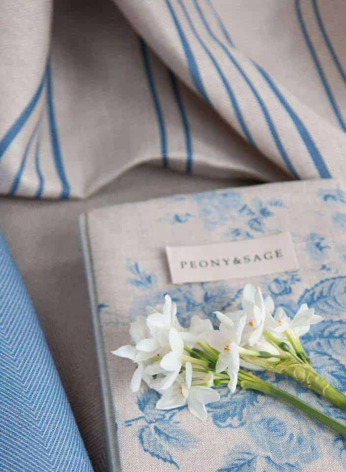 love this faded blue floral linen and striped blue linen by Peony & Sage. Click through for more details and to discover more beautiful faded floral linens you'll love