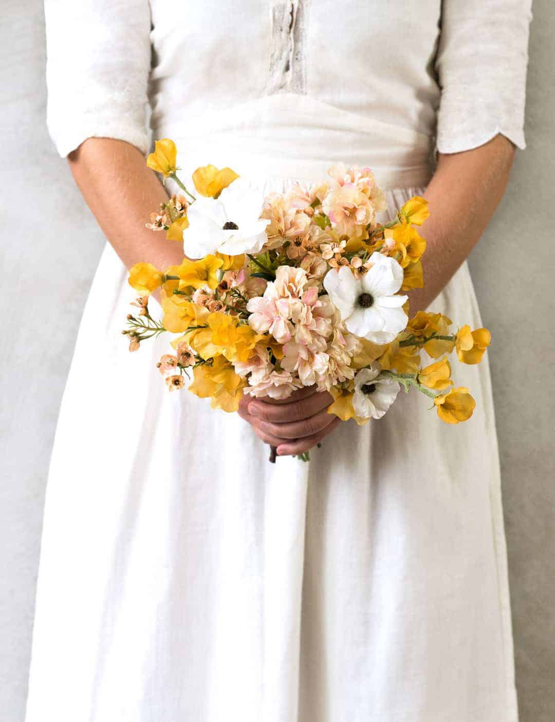 love this faux spring flower posy by Philippa Craddock in yellows, pale blush pink and white. Click through to find out more and to see other beautiful spring flower ideas you'll love
