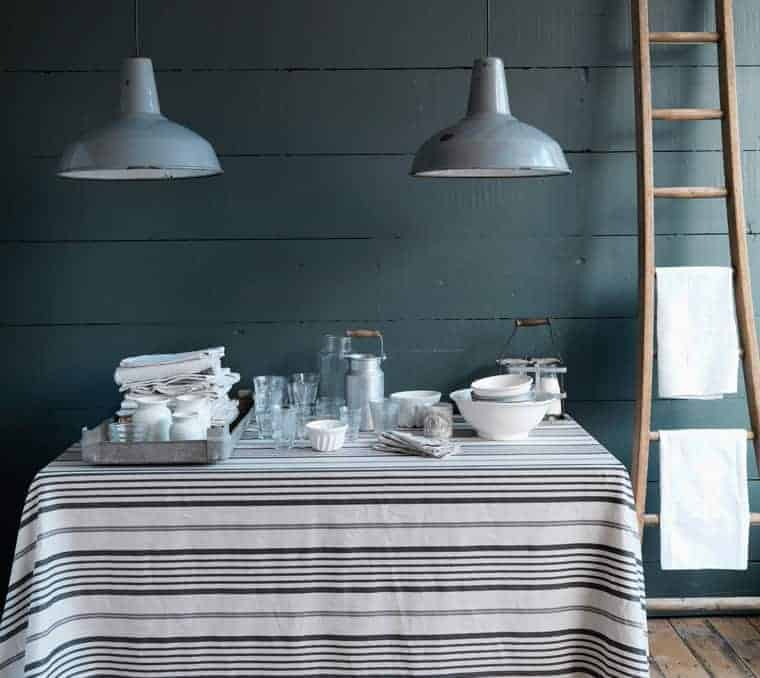 love this grey contemporary country kitchen look from Cabbages and Roses with stripe linens, simple wood and rustic glass and ceramics. Click through for more contemporary grey country kitchen ideas you'll love