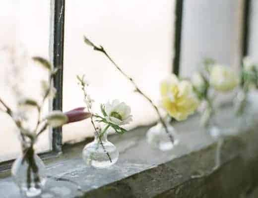 love these simple glass jars of flowers