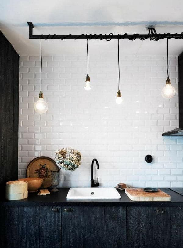 love this modern rustic kitchen with white metro tiles, industrial bulb lighting and black cupboads