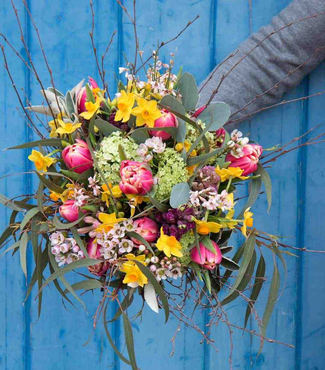 love this love these yellow, pink and white spring flowers by The Real Flower company - pink tullips, yellow daffodils, twigs, blossom and sage with fresh spring green eucaluptus. Click through for more beautiful spring flower arrangement ideas you'll love