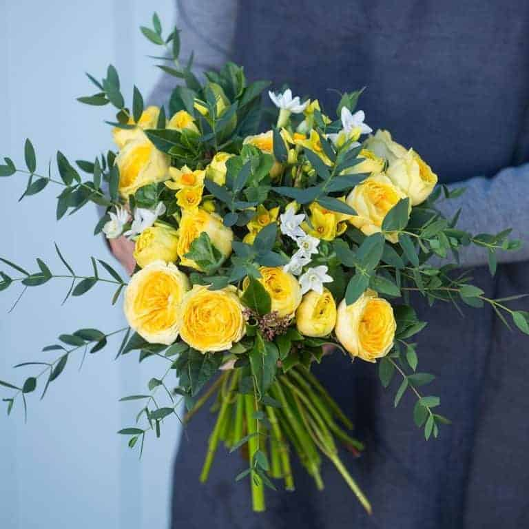 love this yellow ranunculus white narcissi and fresh green spring posy from The Real Flower Company