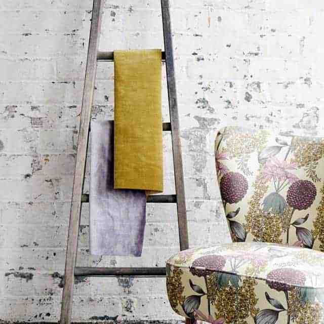 love this faded floral linen covered chair by abigail borg. click through for more faded floral fabric ideas you'll love