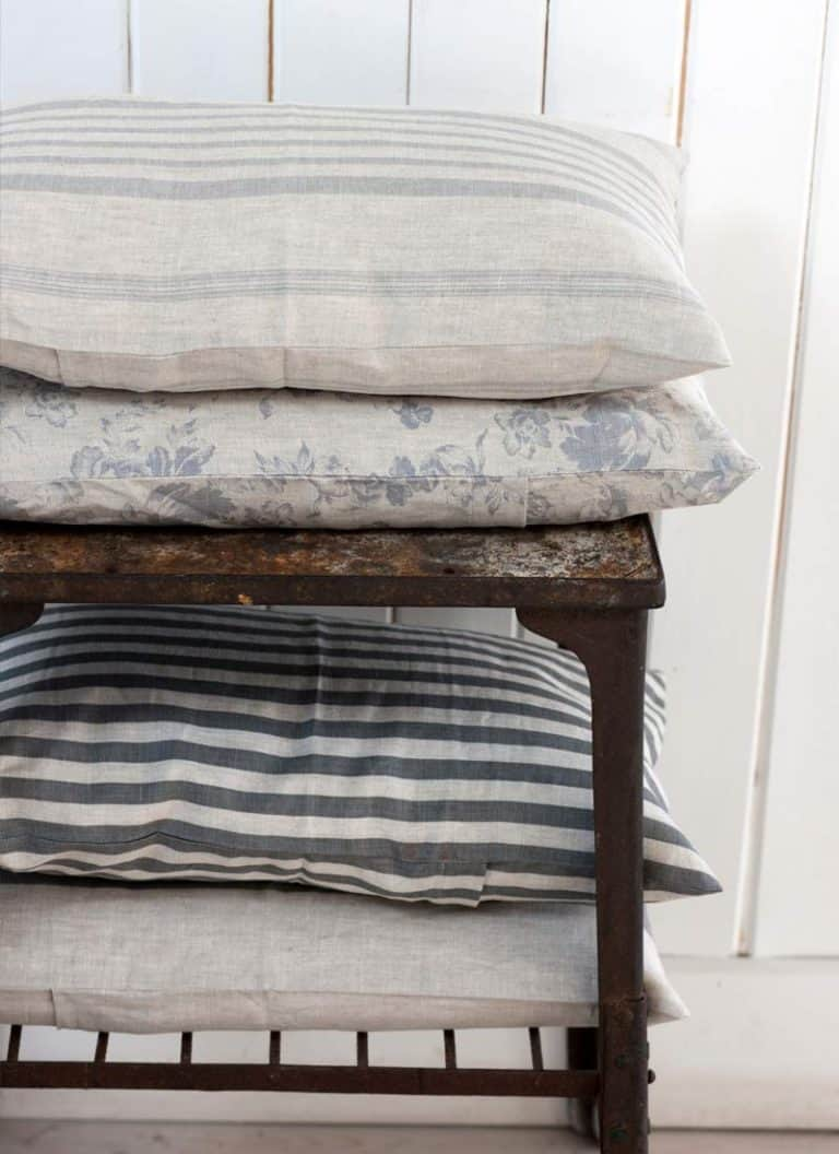 love this pared back grey and neutral stripe and faded floral fabric look from Cabbages & Roses. Click through for more ideas you'll love