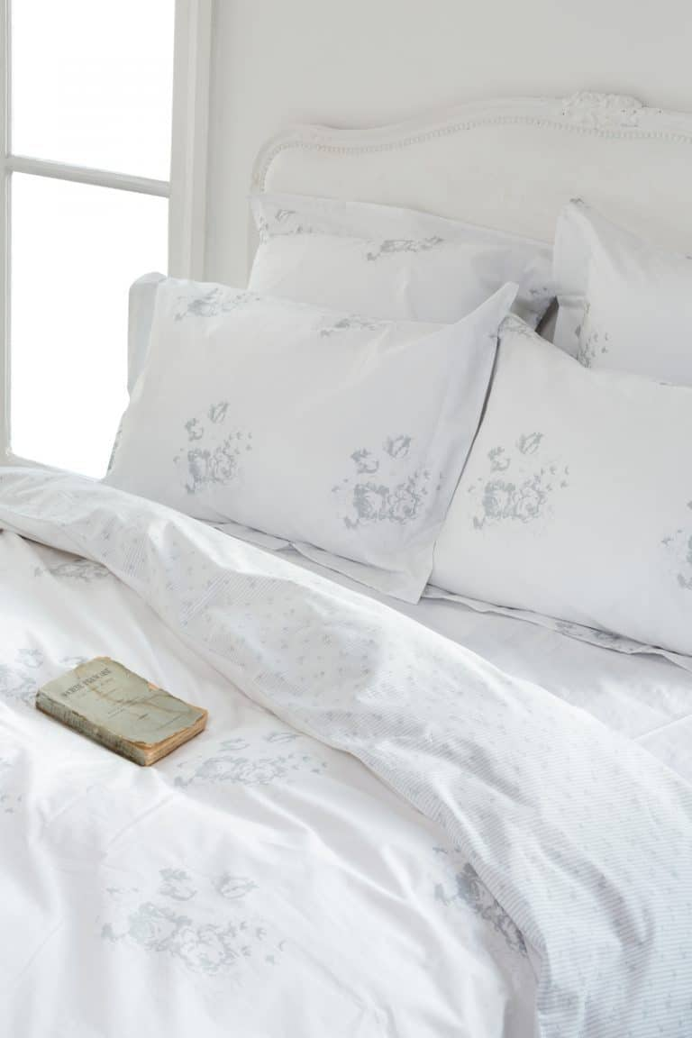 love this pale blue and white faded floral fabric bedroom look by Cabbages & Roses. Click through to discover more faded floral fabric designs you'll love