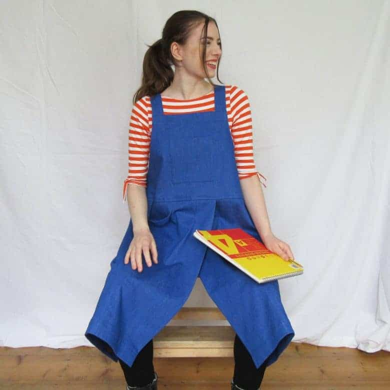 Violet blue denim cross back apron for potters, artists, artisans and workwear. The high split is perfect for pottery makers allowing for easy access to the potter's wheel #artisan #apron #crossback #frombritainwithlove #potter