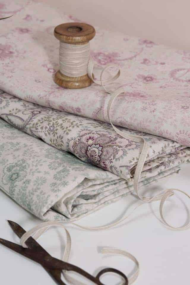love these faded floral fabrics - soft linens in pale pinks, blues and greys by Olive + Daisy. Click through for more faded floral fabrics you'll love