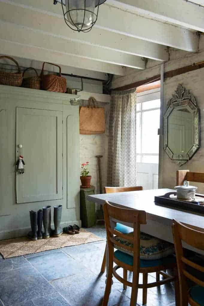 love this welsh farmhouse kitchen with painted green cupboard, flag stone floor and rustic furniture of interiors stylist Hilary Lowe of Damson & Slate