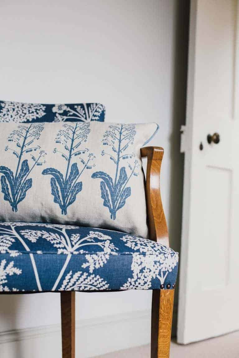 love this blue faded floral linen chair by Madder Cutch & Co. Click through for more faded florals you'll love