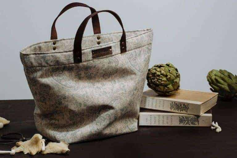love this grey and blue faded floral paisley linen handbag with leather straps hand made by olive and daisy. click through to discover more fabrics you'll love
