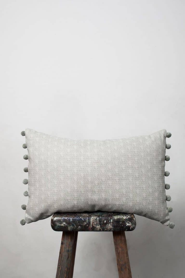 love this pom pom linen cushion in soft grey by olive and daisy. Click through to discover more fabric designs you'll love