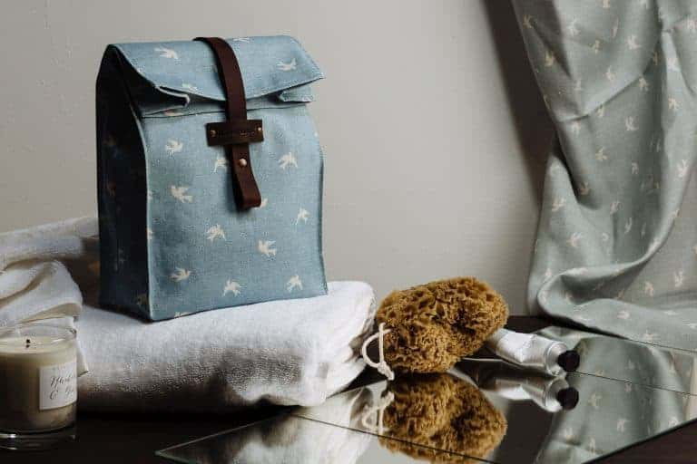 love this olive and daisy rolltop washbag in blue sklark linen