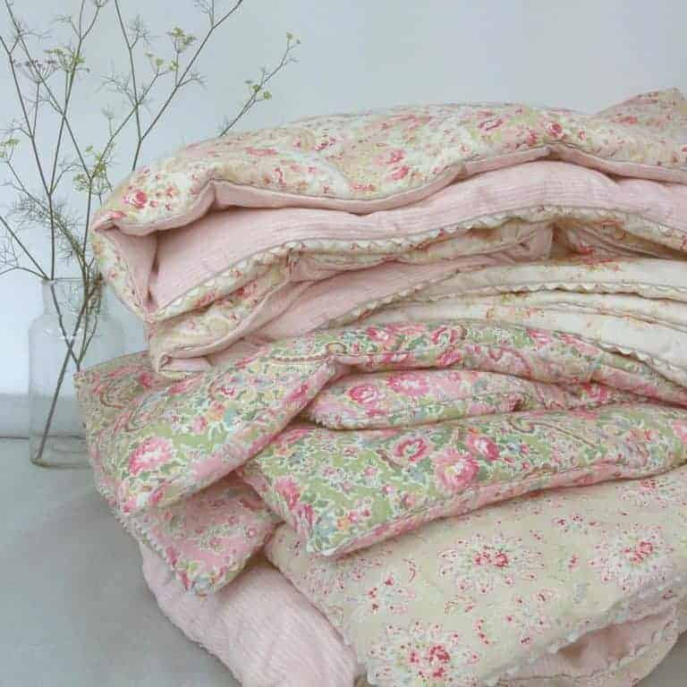 love these vintage inspired faded floral fabric eiderdowns by Sarah Hardaker. Click through to discover more faded floral fabric designs you'll love
