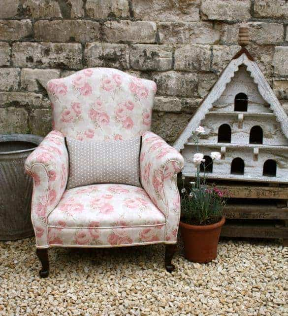 love this faded floral fabric covered armchair by Sarah Hardaker. Click through to discover more faded floral fabric designs you'll love