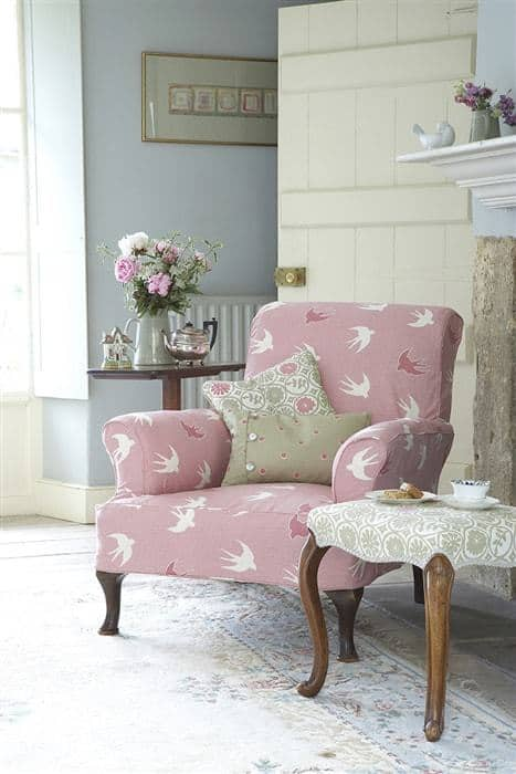 love this pretty pink faded floral fabric covered armchair by Vanessa Arbuthnott. Click through for more faded florals you'll love