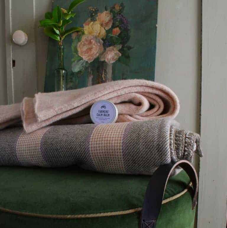 love this green velvet pouffe by tuffet.co, farmers' calm balm and damson and slate welsh blanket