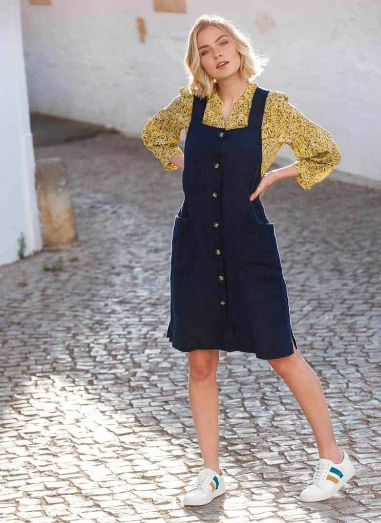 love this dark blue navy linen pinafore dress with buttons and side slits ethically made in britain by Brora click through for more pretty summer dress ideas we love right now #dress #linen #madeinbritain #frombritainwithlove