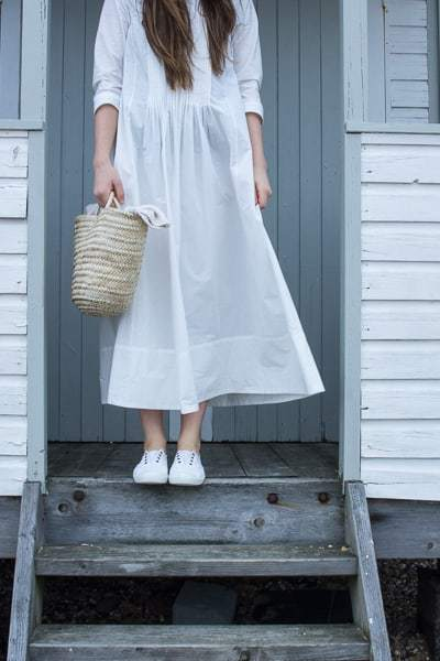 love this simple white linen dress with pintucks by cabbages and roses. The perfect white summer dress to last a lifetime made in soft, natural pure linen and made to last. Click through to discover my other favourite linen dresses