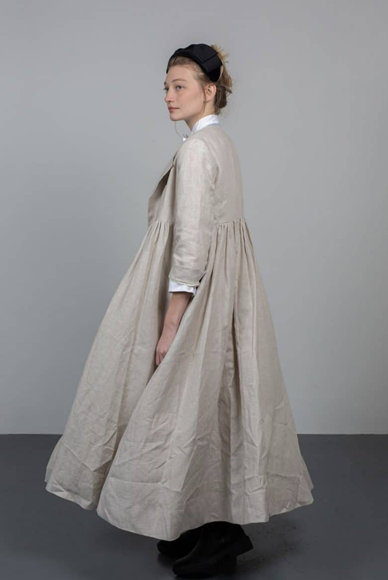 linen dress coat by cabbages and roses in tumbled natural linen with empire line and double row of buttons. Love the swing and soft drape #linen #dress #ideas #coat #frombritainwithlove