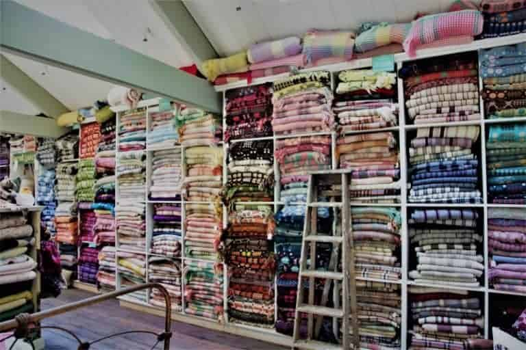 love the stacks of vintage welsh blankets at jane beck's shop. Click through for welsh blanket ideas you'll love