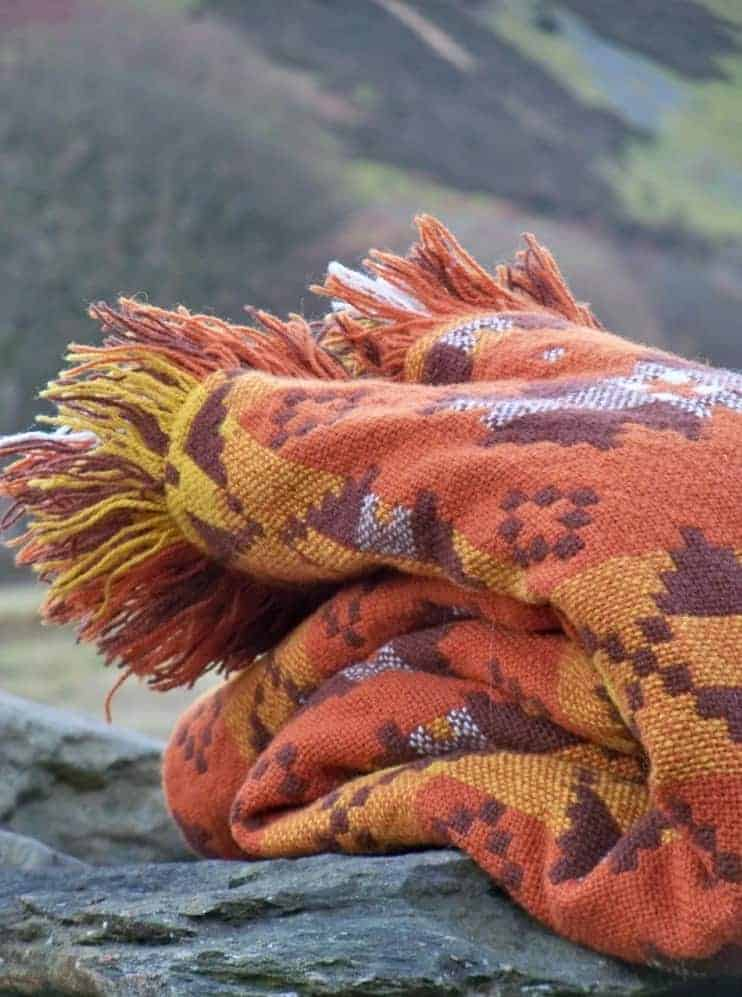 love this orange welsh blanket by jane beck. Click through for more welsh blanket ideas you'll love