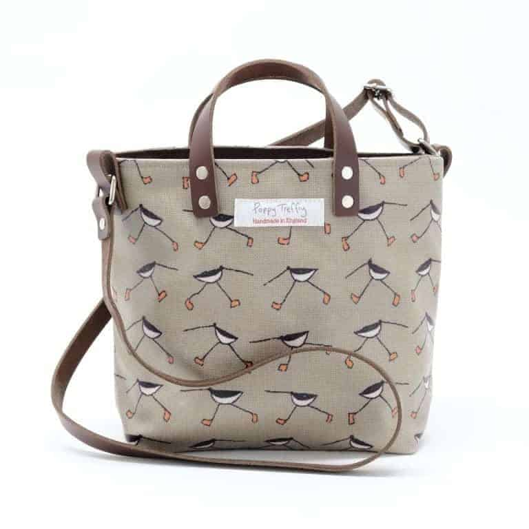 love this poppy treffry oyster catcher cross body bag in printed stone beige linen with brown leather handles made in cornwall england. Click through for more bag ideas you'll love