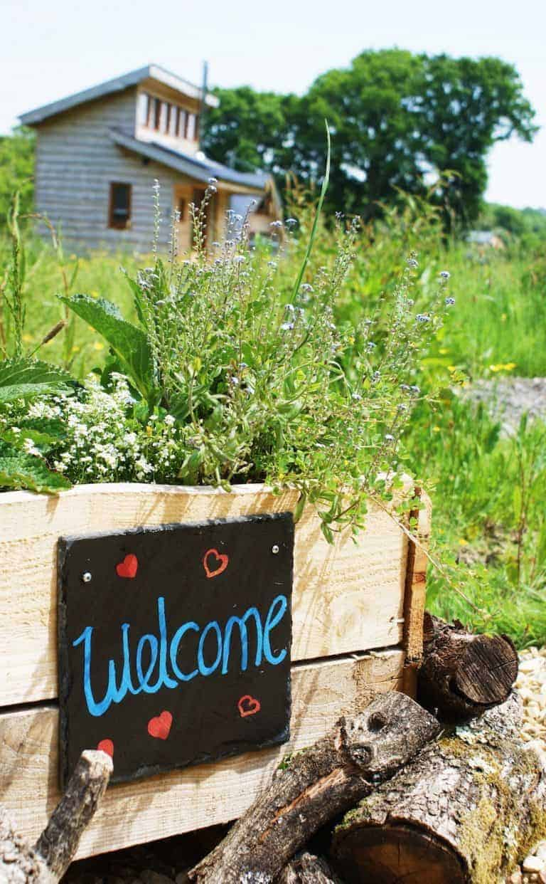 love the welcome sign at eco holidays Tiny Homes on the Isle of Wight. Click through for more beautiful images
