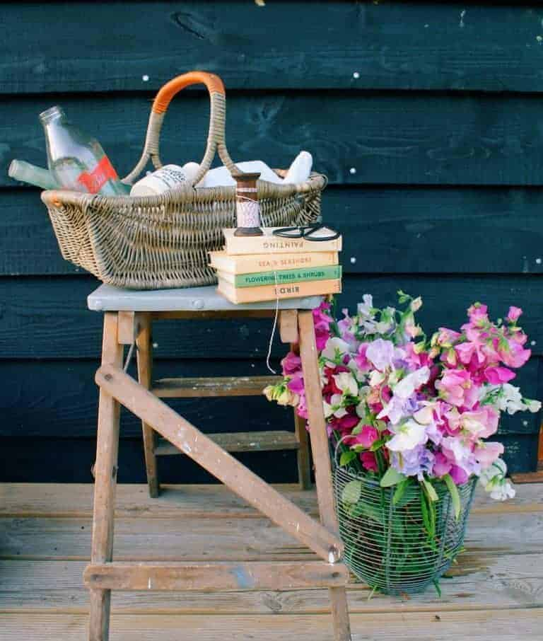 love this basket with sweet peas and vintage books at eco cabin tiny home on the isle of wight