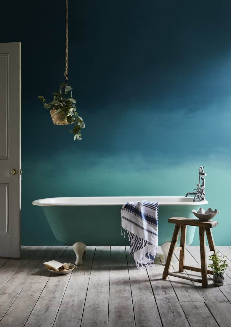 love this dark greeny blue bathroom decorating idea using annie sloan chalk paint to create a modern rustic feel with roll top vintage bath, wooden milking stool and rustic wooden floorboards. Click through for full details on these paints as well as other inspiring DIY decorating ideas and green paint inspiration you'll love #decorating #ideas #bathroom #green #anniesloan #frombritainwithlove