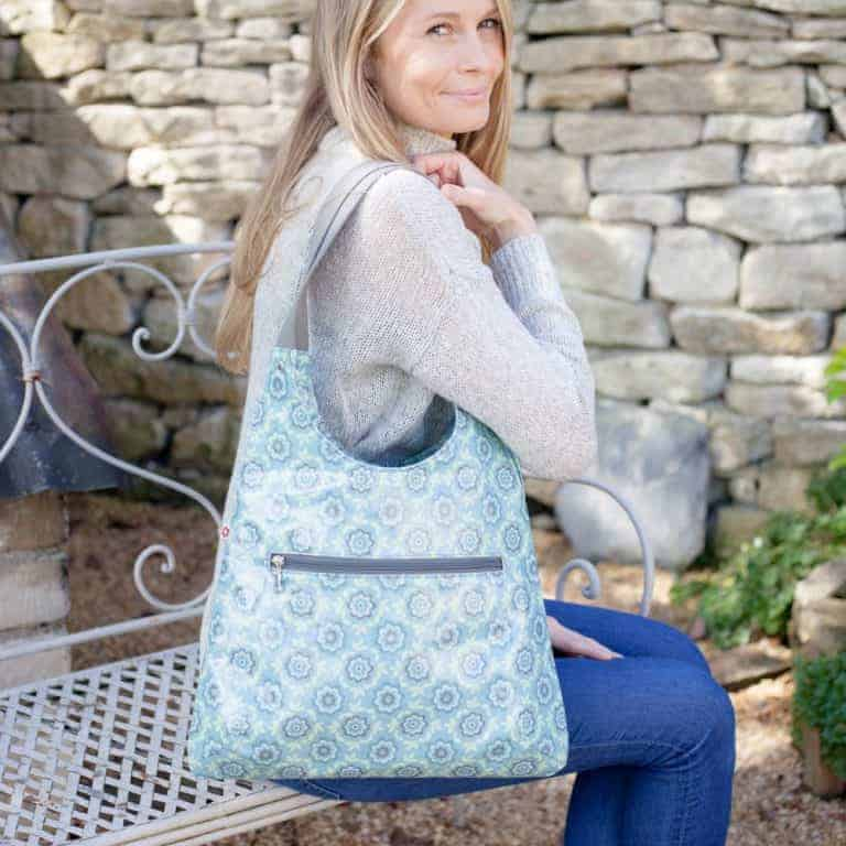 love this pale blue patterned oilcloth shoulder bag by susie faulks made in england and the perfect bag for holding everything you need - vegan and without the use of any animal products