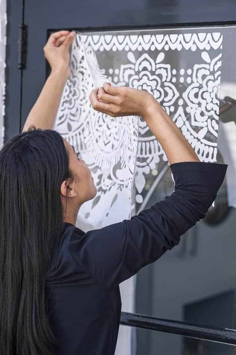 love this idea of painting a white mandala pattern on a window using a stencil. Click through for more paint stencilling ideas you'll love