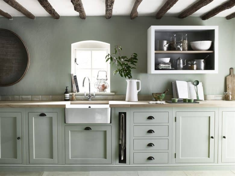 love this green shaker kitchen painted with neptune green paint with open shelving and white marble worktops and splash back. Click through for lots more beautiful decorating ideas with green paint - from pale sage green through bright pea green to the darkest shades of  forest green. #decoratingideas #green #paint #frombritainwithloev #paintshades #kitchenideas