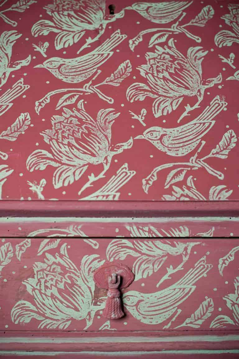 love this painted house decorated chest of drawers with bird and flower in dark red and grey paint