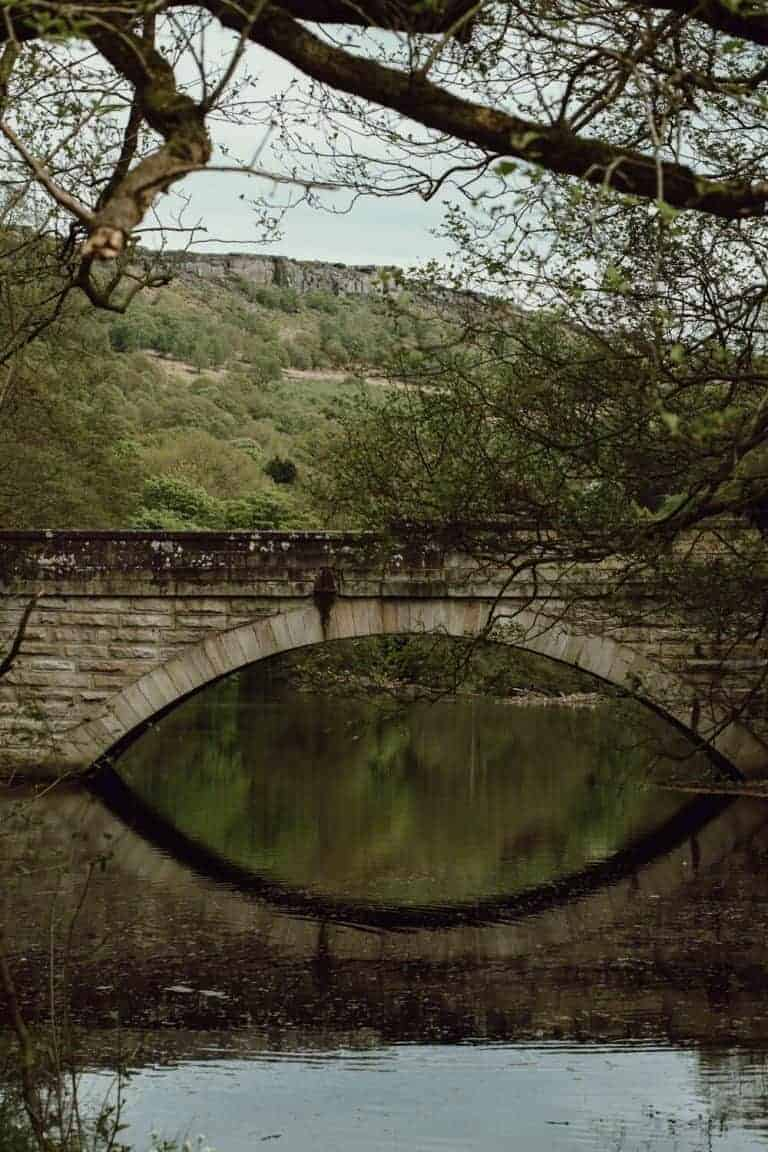 peak district stone bridge over river by oak and claw