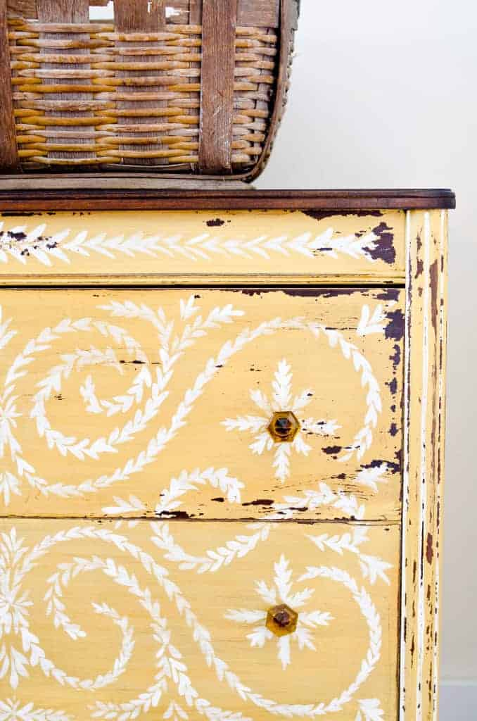love this stencilled yellow painted vintage chest of drawers. Click through for more furniture stencilling DIY ideas you'll love