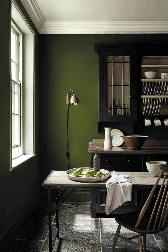 love this deep dark sage green paint colour by Little Greene - Jewel Beetle and dresser painted with Chocolate. Love how the deep green contrasts with the natural wood, deep wood and simple ceramics. click through for more images you'll love of the new green paint colours by Little Greene