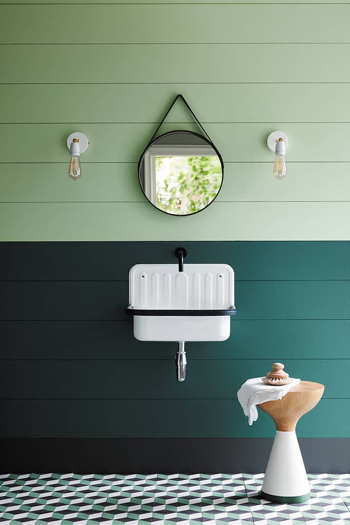 love this dark green and light green paint colour for bathroom with wood plank walls, industrial light and simple white wall hung basin. Click through for more green paint colours for bathrooms you'll love