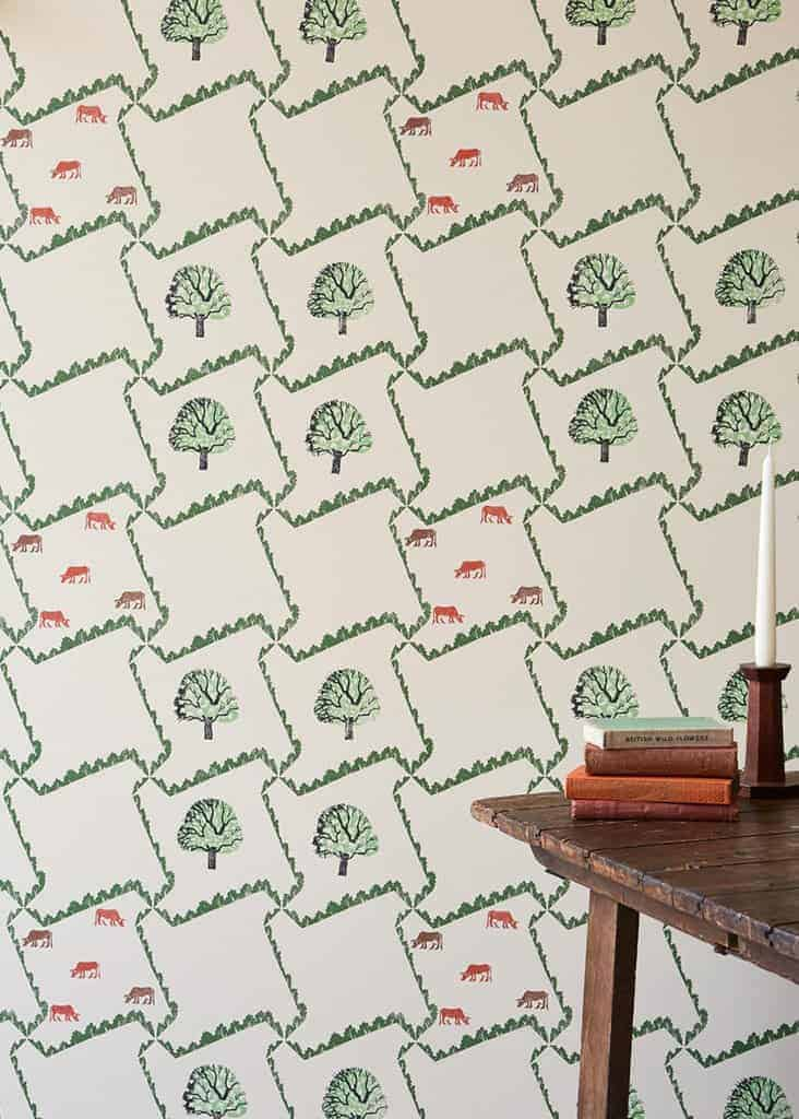 love this tree and cow wallpaper by edward bawden for st judes perfect wallpaper for feature wall. Click through for more feature wall or living room wallpaper ideas you'll love