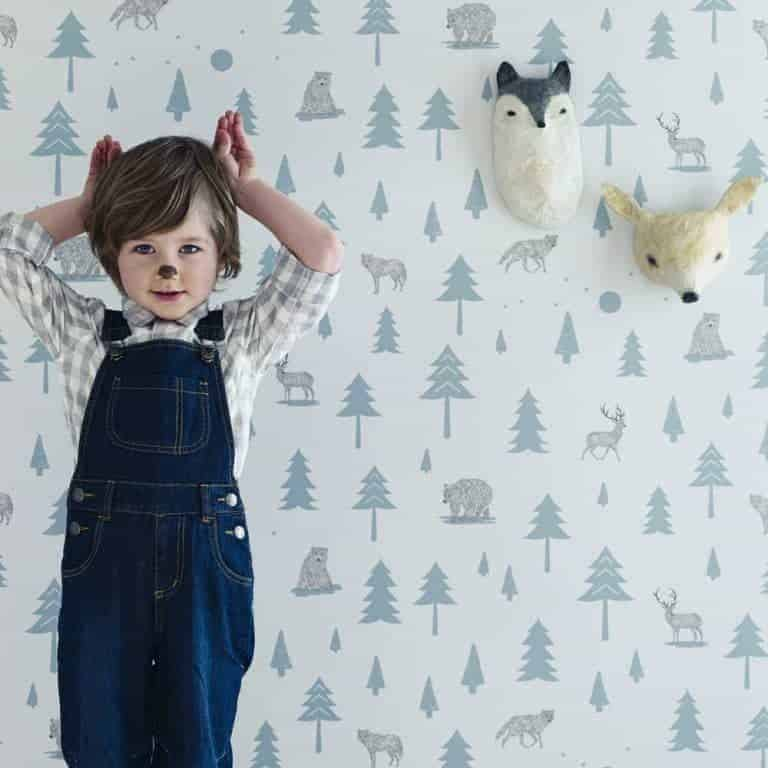 love this pale blue and grey into the wild forest wallpaper hibou home for little boys bedroom. Click through for more wallpaper ideas you'll love for childrens bedrooms, nurseries and more