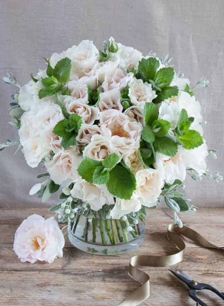 love this pale pink and white hand held old fashioned roses hand held bouquet by The Real Flower Company. Click through for more beautiful images of these old fashioned roses like Margaret Merril and others you'll fall in love with