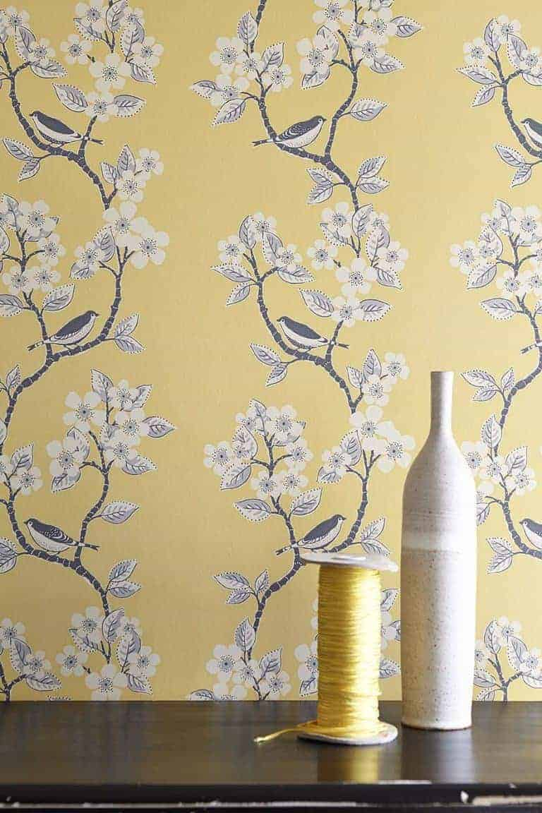 love this buttercup yellow song birds wallpaper by vanessa arbuthnott. Perfect wallpaper for a pretty bedroom or feature wall. Click through for more wallpaper ideas you'll love for rustic country cottage and more
