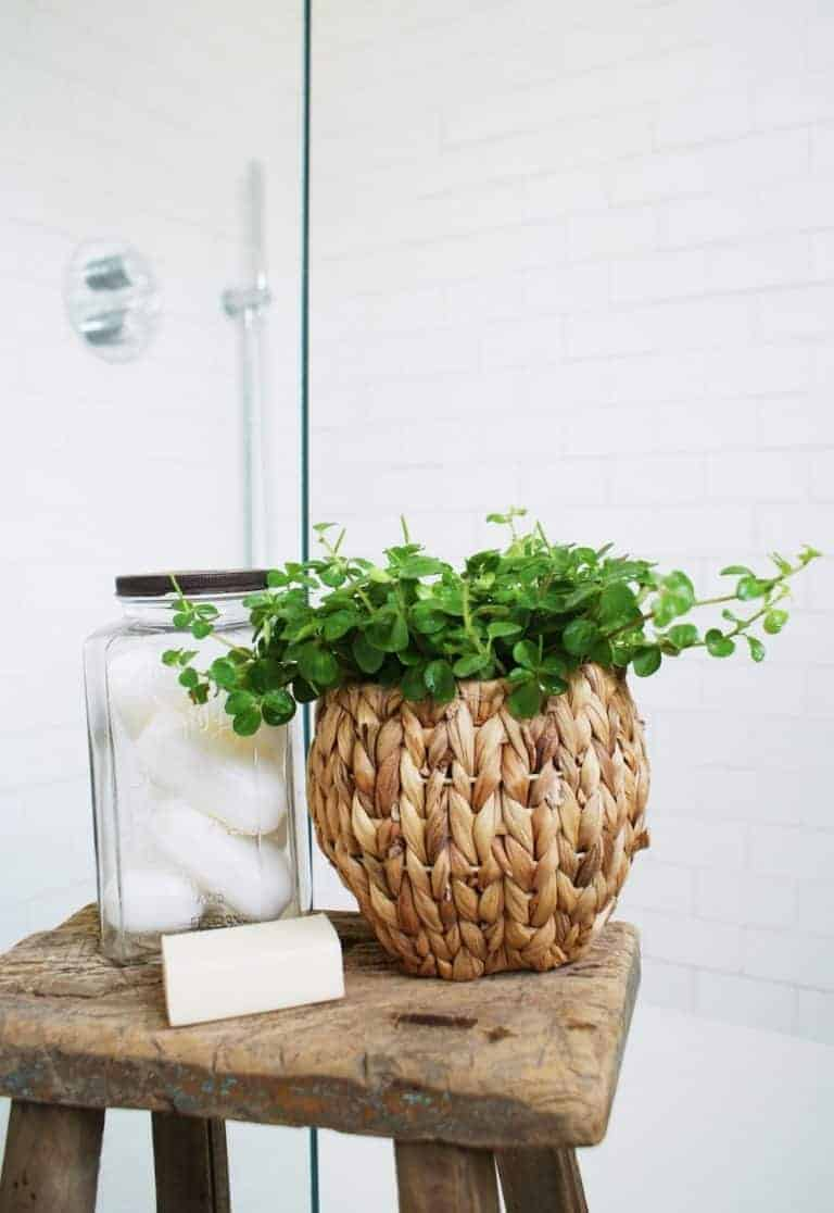 love this white rustic metro tiles shower with patterned floor tiles and vintage milking stool with vintage soap jar and reclaimed wood stool. Click through for eco bathrrom ideas for plastic free and zero waste beauty you'll love