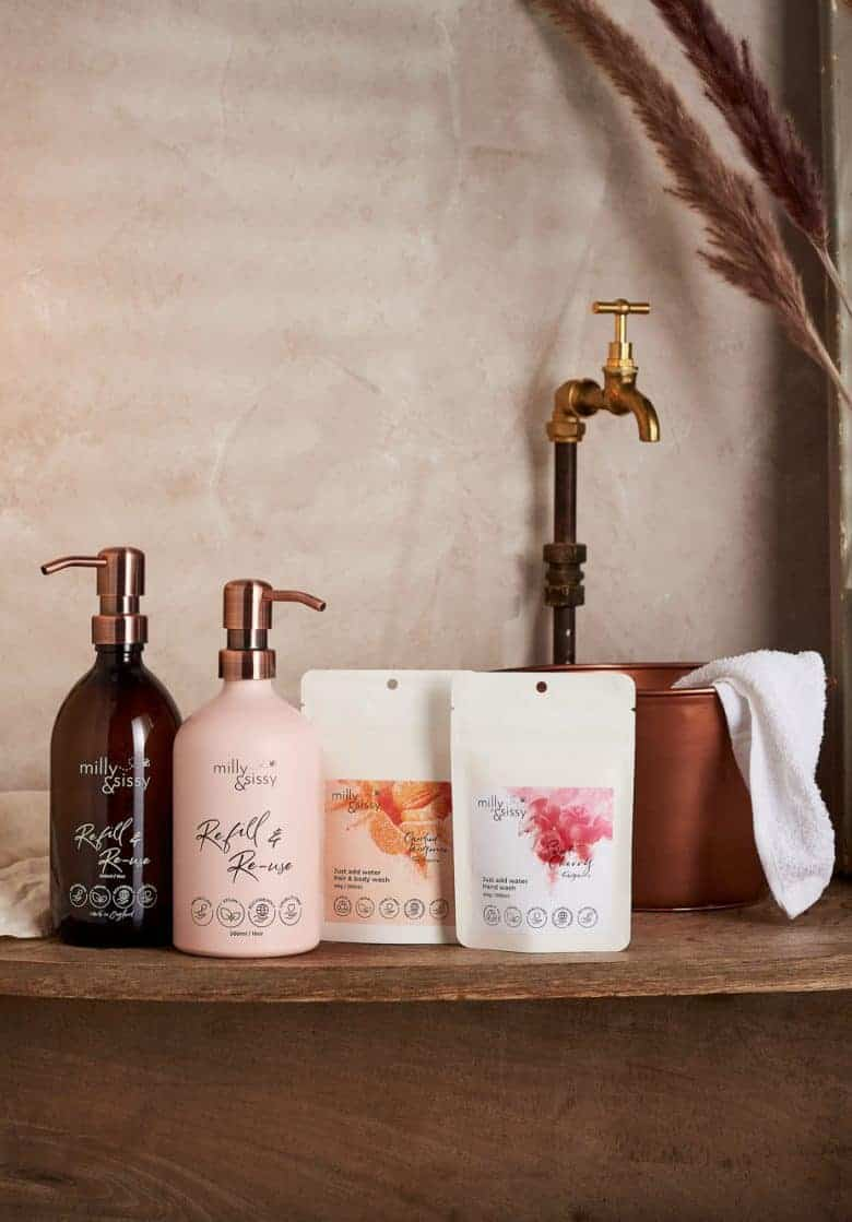 milly and sissy zero waste plastic free eco bathroom handwash body wash refill set - great for moving to a more sustainable bathroom with one amber glass bottle (for hand wash) and one blush aluminium bottle (for the shower) and two compostable refill pouches that just need mixing with water to create beautiful natural hand wash and hair and body wash that is vegan and 99% natural #plasticfre #zerowaste #bathroom #handwash #bodywash #shampoo