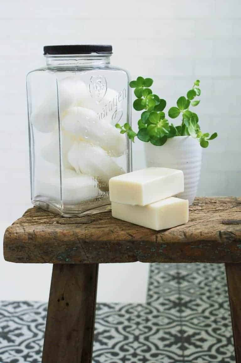love this vintage soap jar and reclaimed wood stool. Click through for eco bathrrom ideas for plastic free and zero waste beauty you'll love
