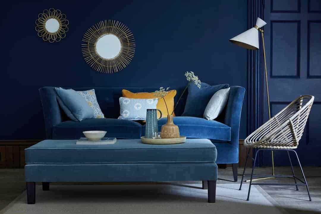 love this deep blue velvet sofa with jewel colour velvet cushion accents by Vanessa Arbuthnott. Click through for more velvet sofa velvet armchair and other velvet ideas you'll love