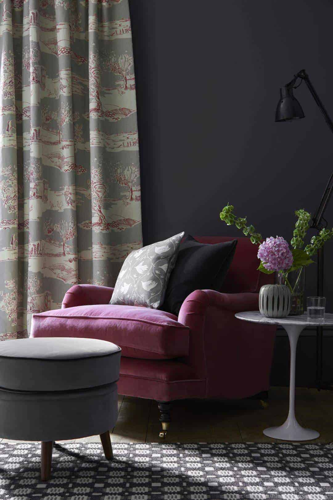 love this deep pink velvet chair with charcoal grey linen cushion and grey velvet footstool.