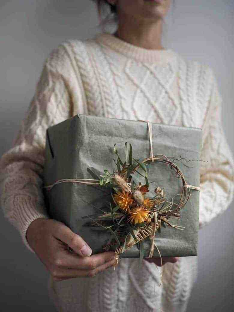 christmas gift wrapping ideas ethical and natural like this mini dried flower wreath as gift wrap decoration by bex partridge of botanical tales who shares other ideas and step by steps. You can also buy these mini wreaths from Bex herself
